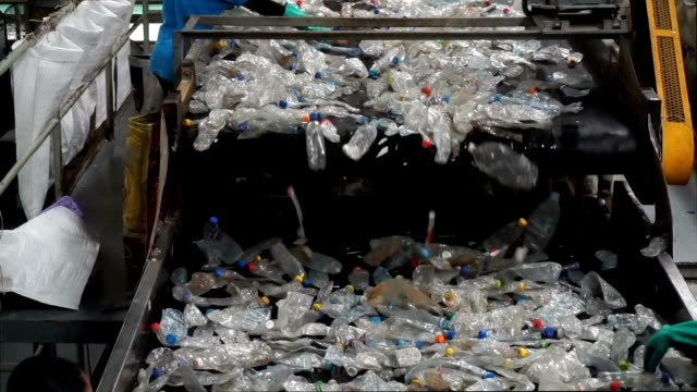 rubbishes flown onto conveyor belt for recycling process - bottle stock videos & royalty-free footage