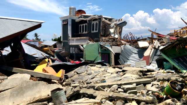 rubble and debris lie around the ruins of a mosque following an earthquake on october 02 2018 in palu indonesia indonesias disaster response agency... - indonesia earthquake stock videos & royalty-free footage