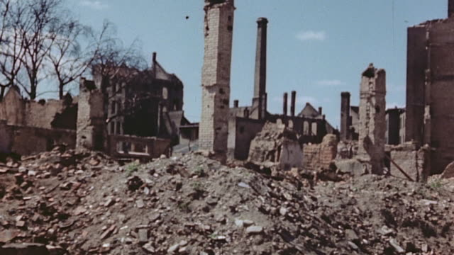 ds rubble and ruins of bombed out buildings with some chimneys still standing / brunswick germany - zweiter weltkrieg stock-videos und b-roll-filmmaterial