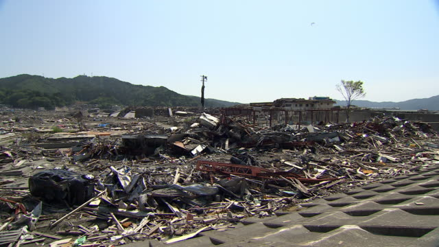 Rubble covers a stretch of land in Iwate Prefecture in the aftermath of a tsunami.