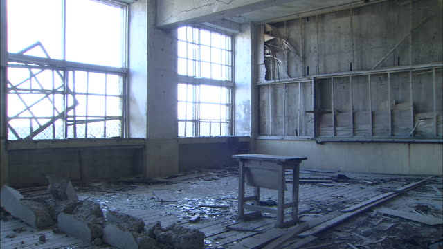 rubble covers the floor of a derelict classroom. - old ruin stock videos and b-roll footage
