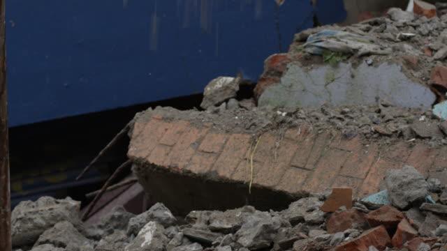 barabise, nepal - july 31, 2015: cu rubble falling - rubble stock videos & royalty-free footage