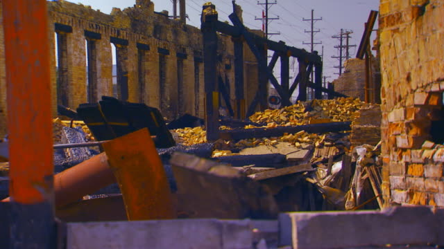 rubble from a burned brick building - rubble stock-videos und b-roll-filmmaterial