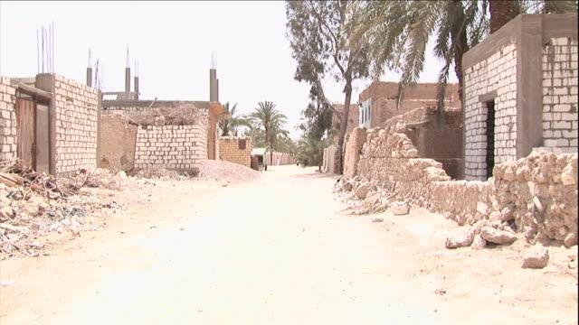 rubble lines a street in siwa, egypt. - ziegel stock-videos und b-roll-filmmaterial