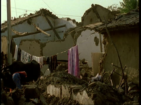 ms rubble of demolished house, washing line draped across, after earthquake, gujarat, india - グジャラート州点の映像素材/bロール