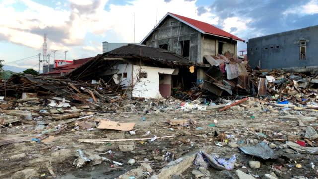 rubble of destroyed buildings lies in the road following a tsunami on october 01 2018 in palu indonesia over 844 people have been confirmed dead... - damaged stock videos & royalty-free footage