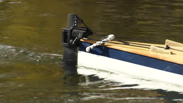 rudder of kayak on surface lake wakatipu otago - rowing boat stock videos & royalty-free footage