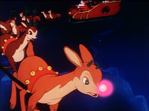 vidéos et rushes de animated rudolph at head of team of reindeer pulling santa's sleigh through the air / sound - caribou