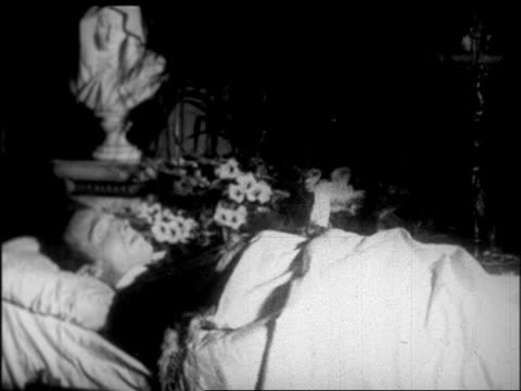 rudolph valentino lying in state in campbell's funeral home / nyc / newsreel - one mid adult man only stock videos & royalty-free footage