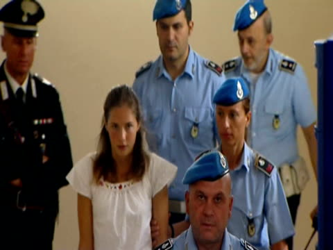 Rudy Hermann Guede handcuffed as escorted into court by police / Amanda Knox led into court by police / High angle shots of officials along in court...