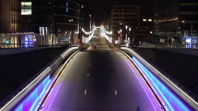 rue de la loi is empty but lit with colored light during the coronavirus pandemic on april 4, 2020 in brussels, belgium. the belgium government has... - belgium stock videos & royalty-free footage