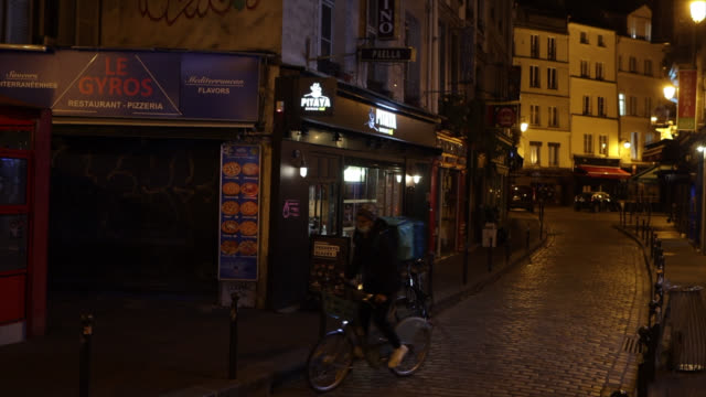 rue de paris with food delivery people in front of an open restaurant at the start of the new curfew in paris, france. the new curfew from 9 p.m. to... - three people stock videos & royalty-free footage