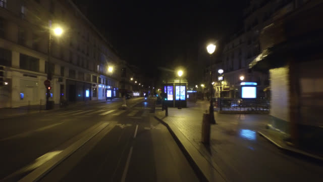rue de rivoli with only one cyclist, without traffic and without pedestrian. april 30, 2020 in paris, france. - point of view stock videos & royalty-free footage