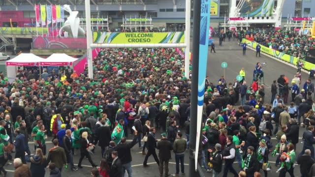 rugby fans gather close to the millennium stadium where ireland are playing argentina in the quarterfinals of the rugby world cup 2015 on october 18... - 2015点の映像素材/bロール