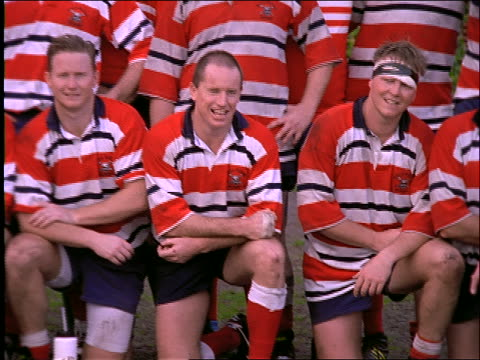 pan of rugby players posing for team portrait - organised group photo stock videos & royalty-free footage