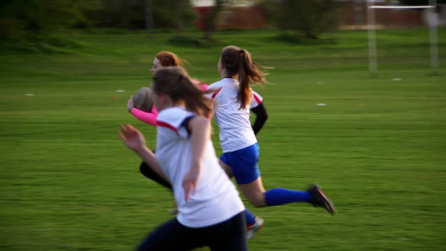 rugby teens chasing a player with the ball - females stock videos & royalty-free footage
