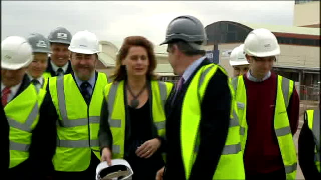 rugby warwickshire college ext gordon brown wife sarah brown and others walking towards during visit to wind turbine factory birmingham edgbaston... - warwickshire stock videos & royalty-free footage