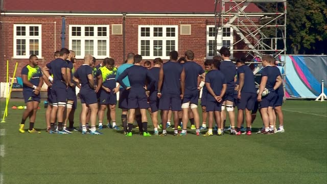 rugby world cup 2015: australia rugby team training; england: london: dulwich college: ext australia rugby team training on pitch - australian national team stock videos & royalty-free footage