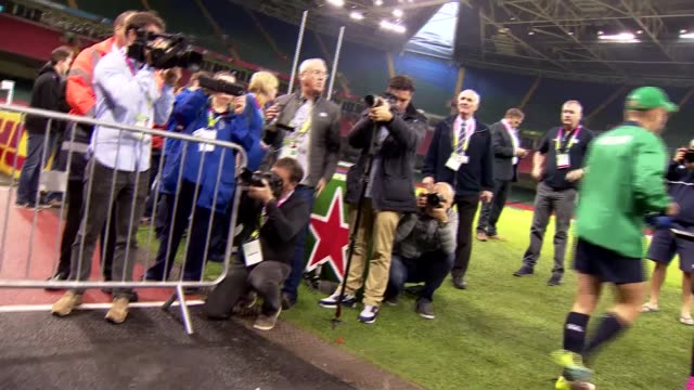 Rugby World Cup 2015 Ireland training WALES Cardiff Millennium Stadium EXT Various of Ireland Rugby Union squad onto pitch and warming up