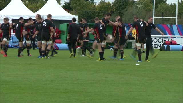 rugby world cup 2015: welsh rugby team training; various shots welsh rugby team training on pitch - typisch walisisch stock-videos und b-roll-filmmaterial