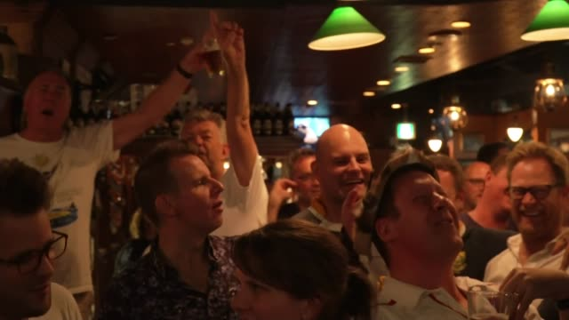 fans prepare for england v south africa final; japan: tokyo: int reporter to camera england rugby fans in bar as watching tv showing wales v new... - television game show stock videos & royalty-free footage