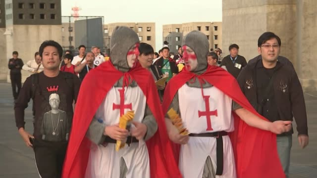 group stage matches; japan: sapporo: sapporo dome: ext england fans dressed as knights arriving england fan wearing face paint and hat arriving... - fan enthusiast stock videos & royalty-free footage
