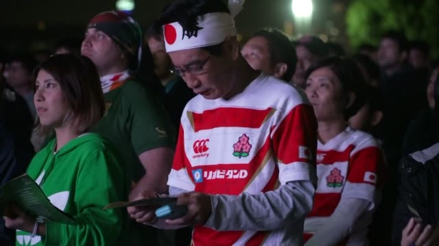 south africa beats england in final japan yokohama ext various shots of england fans arriving at stadium dressed in england jerseys and costumes... - japan stock videos & royalty-free footage