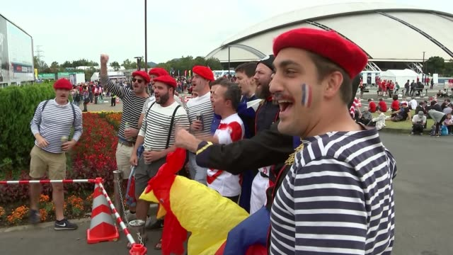 wales reach semi-finals; japan: kyushu island: oita prefecture: oita: showa denko dome oita: ext france supporters wearing berets and striped breton... - east asian ethnicity stock videos & royalty-free footage