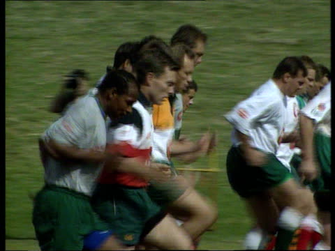 stockvideo's en b-roll-footage met preview itn africa durban ext ms members of england rugby world cup squad off bus towards and past int cms england captain will carling holds mail... - 1995