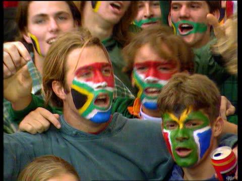 south africa beat australia in opening match anat africa cape town newlands stadium ms sa fans with faces painted singing sot cms sa fan wearing cap... - fan enthusiast stock videos & royalty-free footage