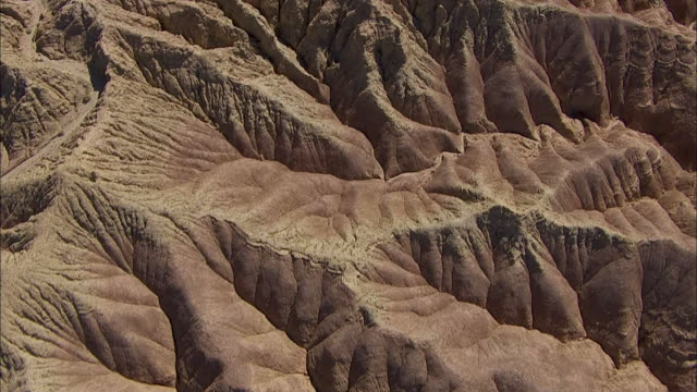 rugged badlands characterize a california desert. - badlands stock videos & royalty-free footage
