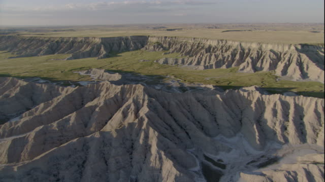 rugged badlands characterize miles and miles of south dakota's plains. available in hd. - badlands national park video stock e b–roll
