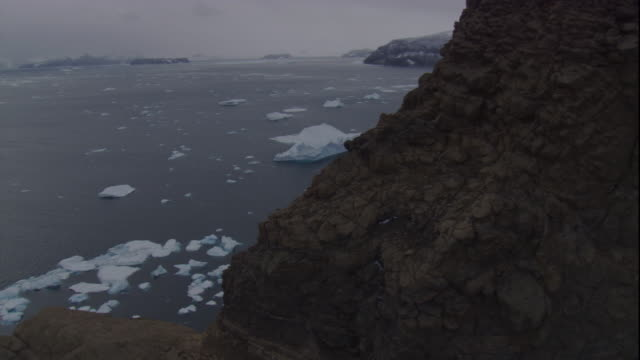 rugged cliffs and icy southern ocean off the coast of antarctica. - bbc stock videos and b-roll footage