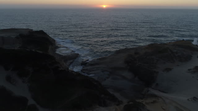 rugged coastline at sunset - tilt stock videos and b-roll footage
