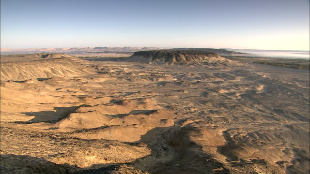 rugged hills stretch across a vast desert. - dry stock videos & royalty-free footage