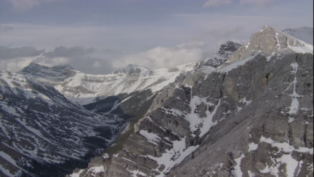 rugged peaks drop down to the valleys of banff national park in canada. available in hd. - banff stock videos & royalty-free footage