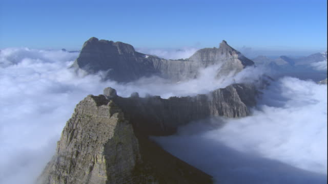 Rugged peaks zigzag through a blanket of clouds. Available in HD.