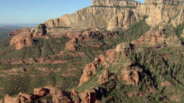 rugged rock formations characterize a desert near sedona, arizona. - sedona stock videos & royalty-free footage