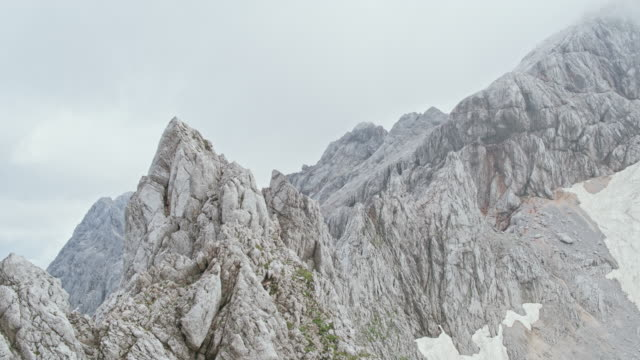 aerial rugged rocky mountain top - slovenia stock videos & royalty-free footage