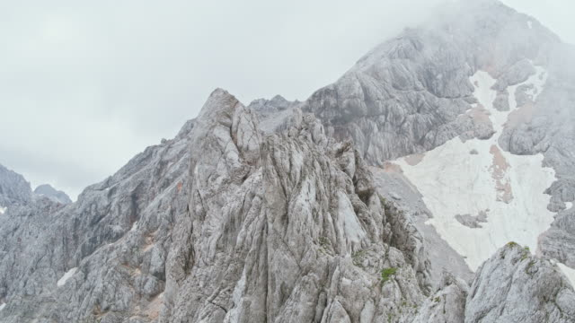 aerial rugged rocky top of a mountain - fog stock videos & royalty-free footage