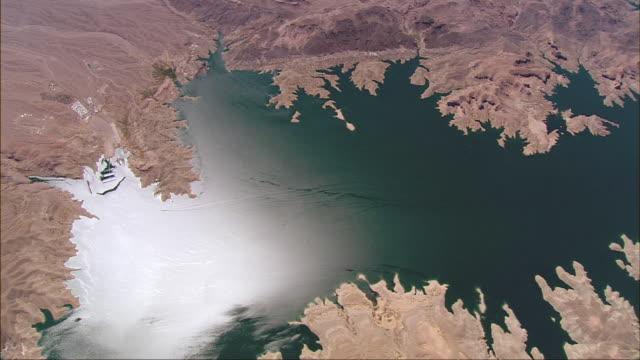 a rugged, unusual shoreline surrounds lake mead. - lake mead video stock e b–roll