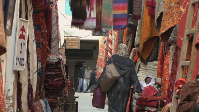 ws rugs on display in medina, essaouira, morocco - old town stock videos & royalty-free footage
