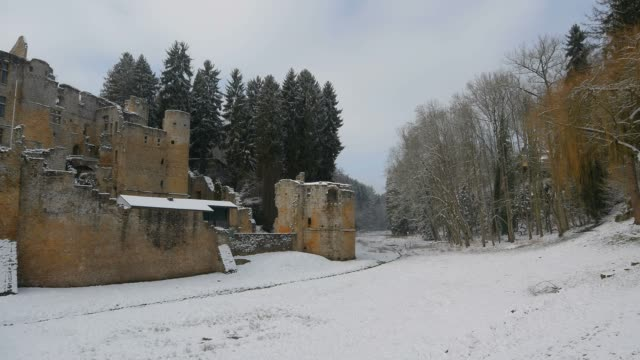 ruin of beaufort castle in beaufort in winter, canton of echternach, luxembourg, europe - circa 11th century stock videos & royalty-free footage