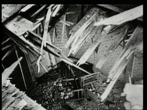 ruined buildings in aftermath of world war ii bombing/ woman pointing to hole in damaged apartment ceiling/ woman plastering damaged wall/ two young... - bildkomposition und technik stock-videos und b-roll-filmmaterial