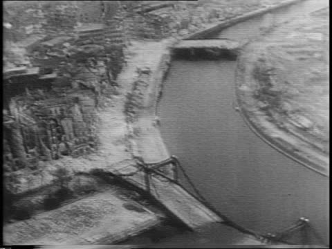 vidéos et rushes de ruined buildings in berlin / brandenburg gate / spree river / destruction near river / ruined bridge / ruined city / ruined business buildings /... - 1945