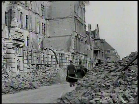 ruined german city refugees walking ws rubble of building world war ii wwii aftermath postwar destruction bombed debris - zweiter weltkrieg stock-videos und b-roll-filmmaterial