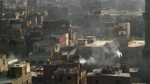 WS Ruined houses with smoking chimney / Cairo ,Egypt
