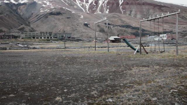 ruined kids playground with seagulls flying around in pyramiden, a soviet ghost town on the archipelago of svalbard - 1927 stock videos & royalty-free footage