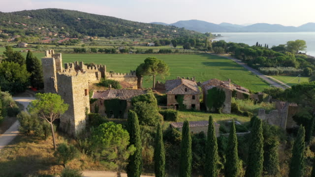 ruined zocco castle on lake trasimeno, umbria, italy - fortress stock videos & royalty-free footage