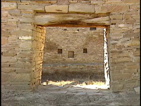 ruinous doorways frame a stone wall of the casa rinconada in chaco canyon, new mexico. - chaco canyon stock videos & royalty-free footage